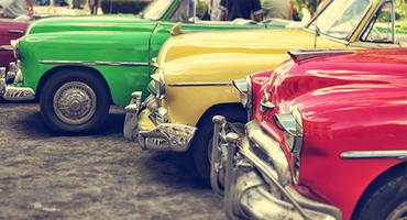 Bright colored vintage cars.