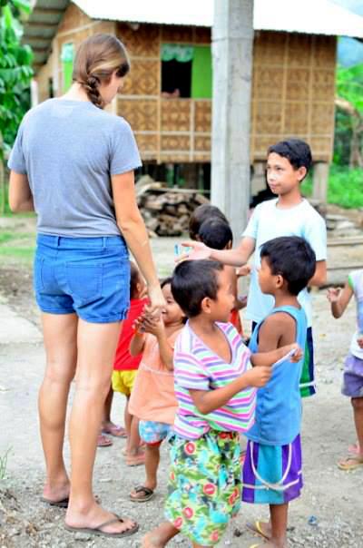Children in a rural village with volunteer