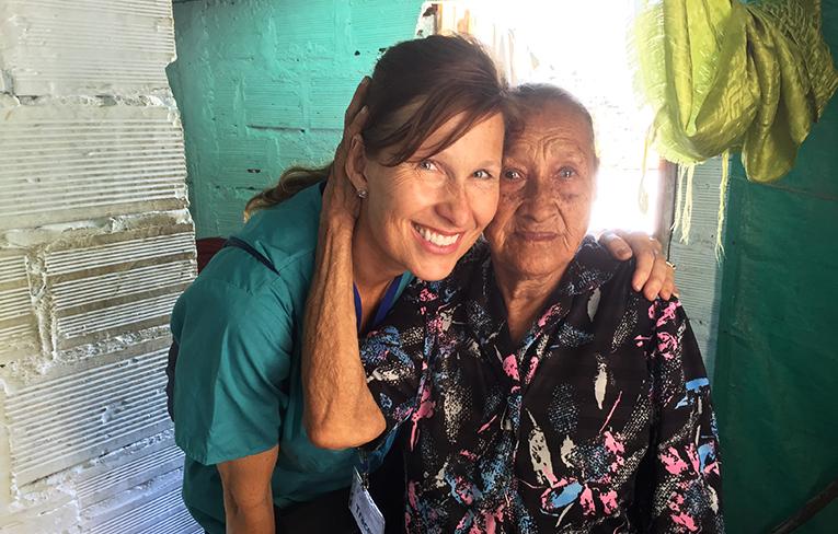 Volunteer nurse in Colombia with an elderly patient