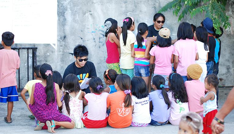 Volunteers teaching kids some songs