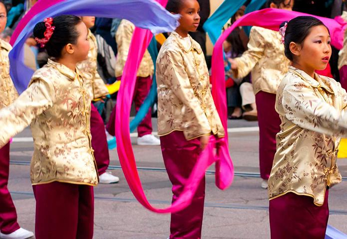 Children dancing in a parade in China