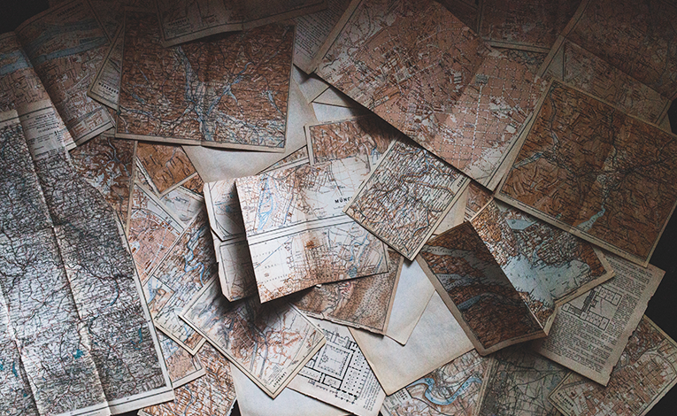 Maps laid out on a table
