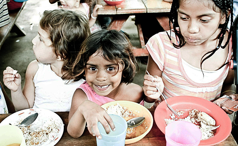 Kids eating in an orphanage