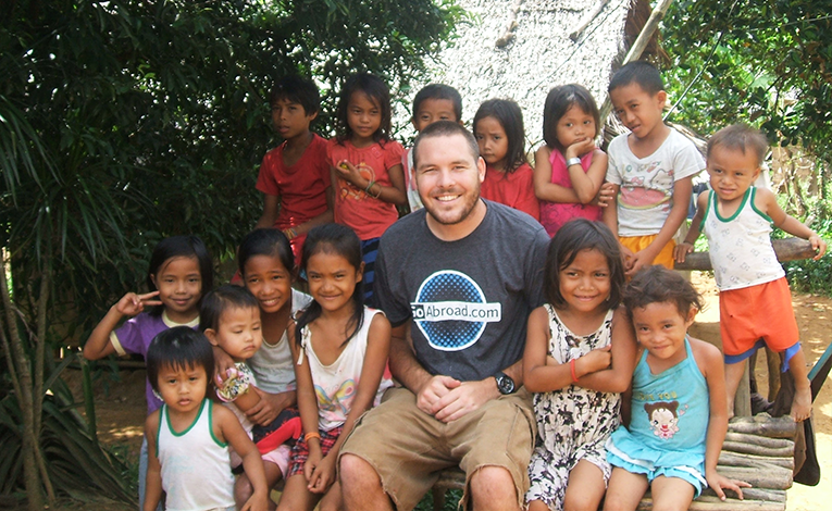 A volunteer with kids in the Philipppines