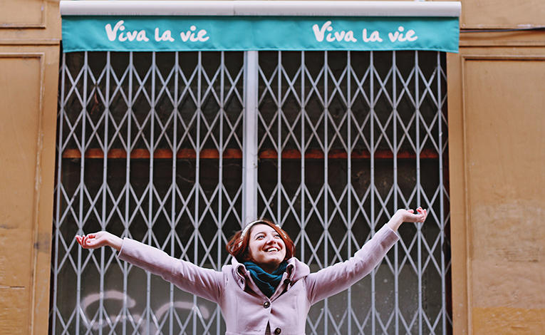 woman smiling with outstretched arms in France