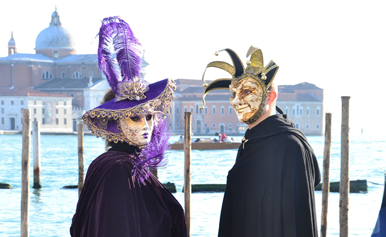 Man and woman wearing masks in Venice, Italy
