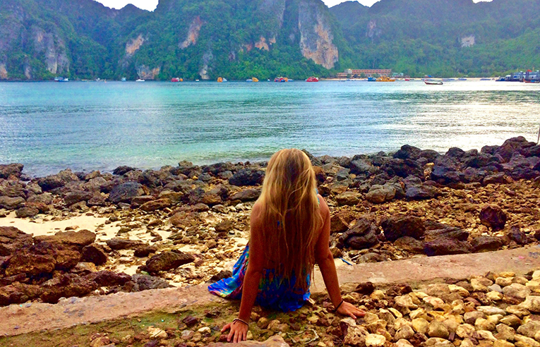 Girl relaxing on the beach on Koh Phi Phi Island in Thailand
