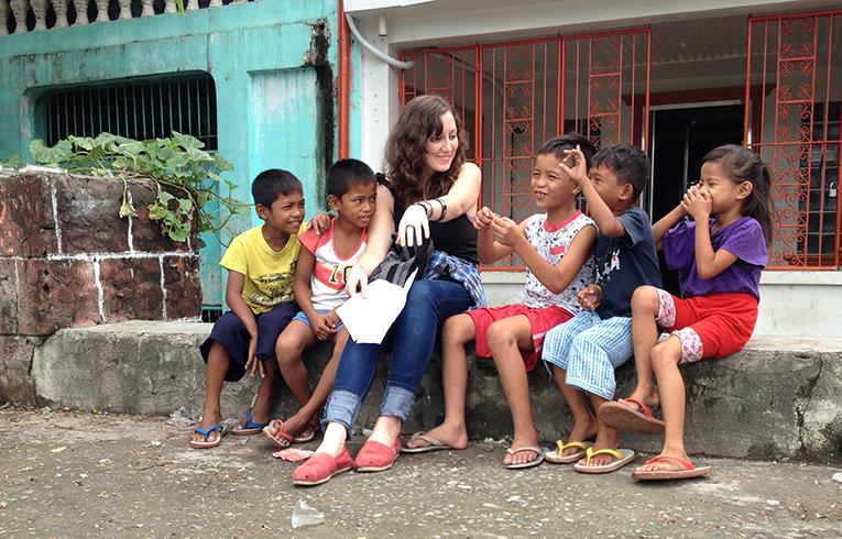 Volunteer teaching the kids