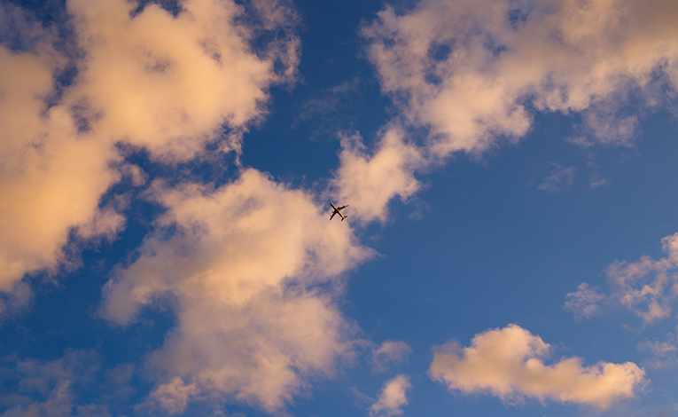 plane flying over the skies