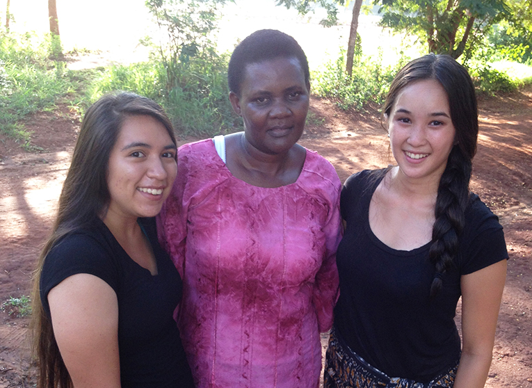 Volunteers with a local woman in Africa