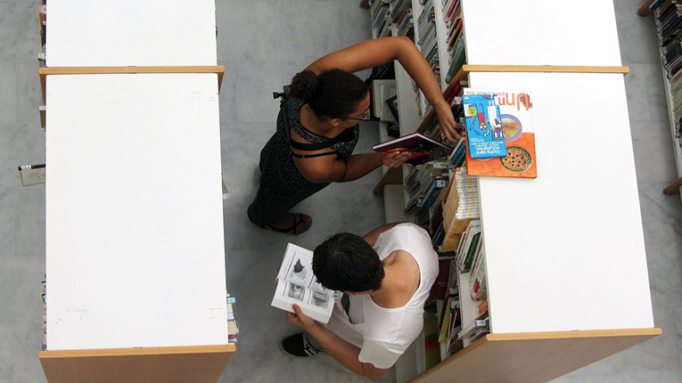 Students choosing books in a library