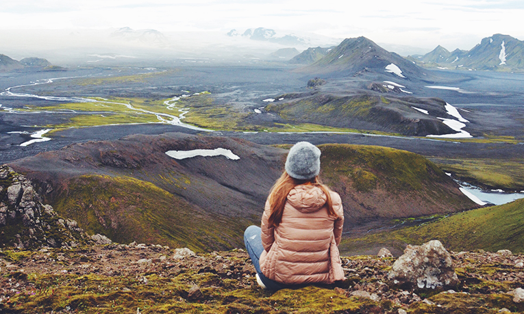 Girl looking at a mountain scene in Iceland