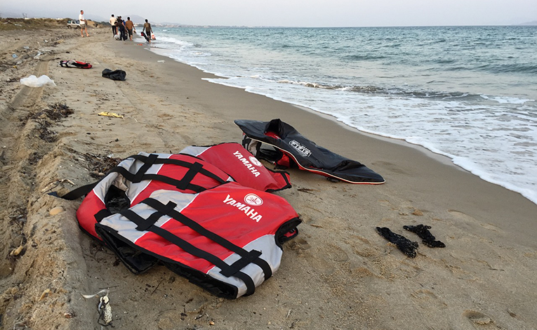 Life vests on beach in Greece.