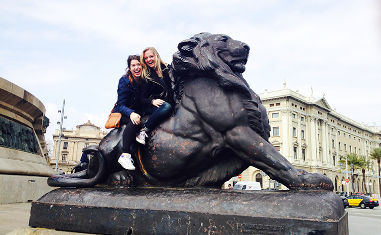 Women on a Lion statue in Barcelona, Spain