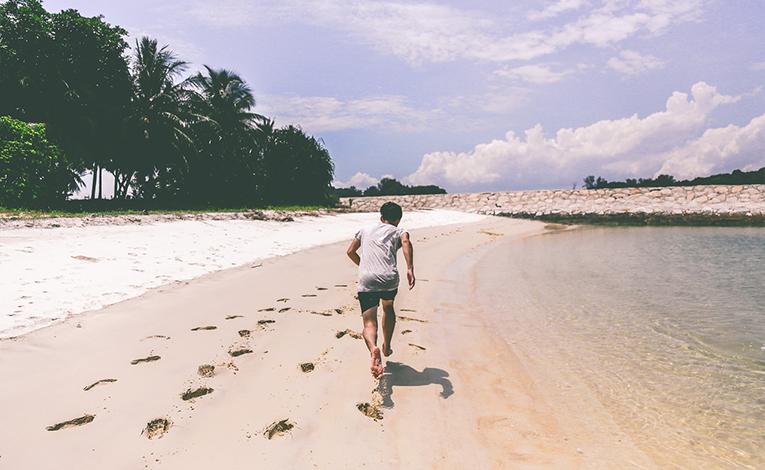Boy running on beach