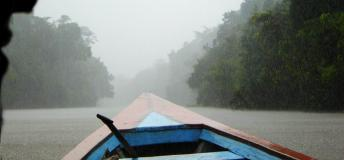 Boating down the Amazon River in the rain
