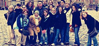 Students pose in the streets of Helsinki during a Spring trip