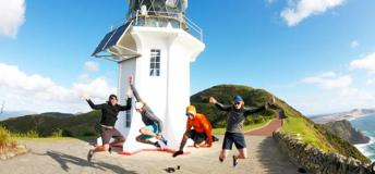 Mark and his friends at Cape Reinga – the tip of the North Island and the start of the 2-month cycling tour