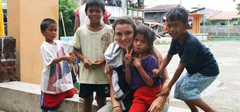 Volunteer with children in the Philippines