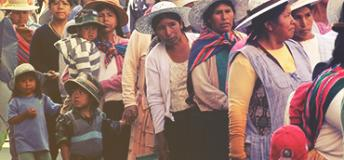 Bolivian women and children standing in a line