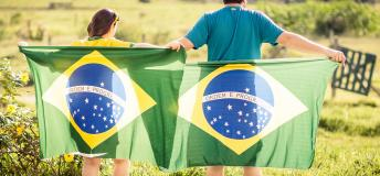 man and woman with Brazilian flag