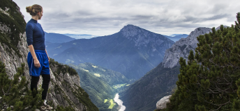 woman trekking in the Julian Alps surrounding Slovenia
