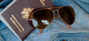 Passport, jacket, and sunglasses