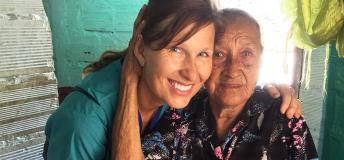 Nurse volunteer abroad in Colombia with an elderly patient