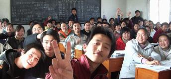 Class photo of students sitting at desks