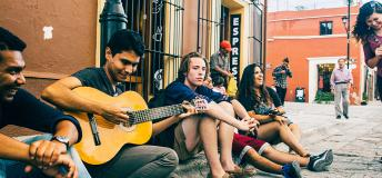 Young people playing music on a street