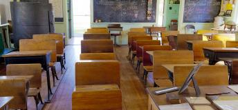 Empty classroom with wooden desks