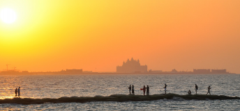 bright orange sunset over the water in Dubai, UAE
