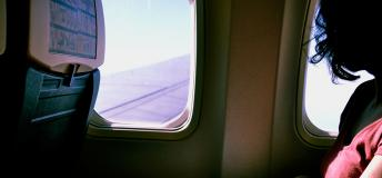 Passenger looking out the window of an airplane