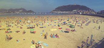 A lot of people playing in the beach in Gibraltar.