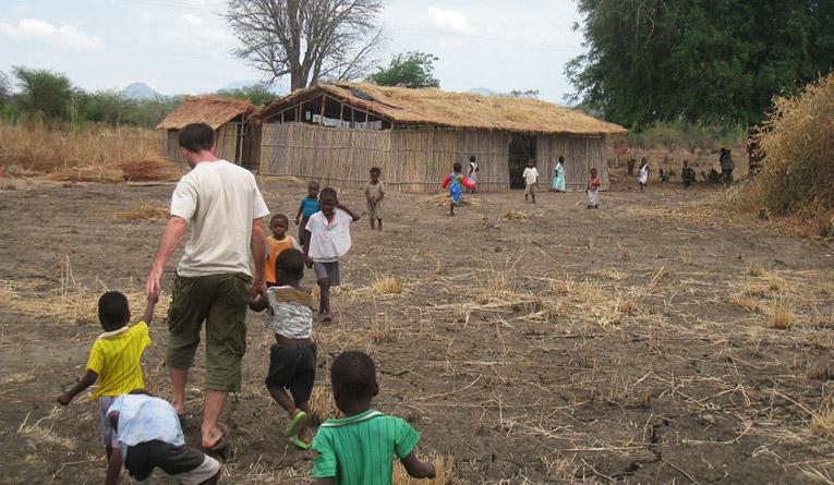 School children with volunteer in Africa