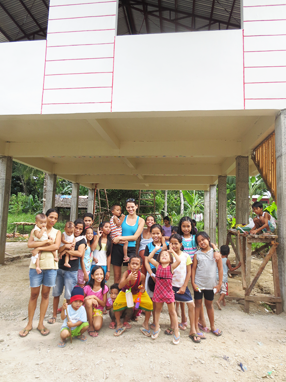 Volunteer with children at a community center in the Philippines