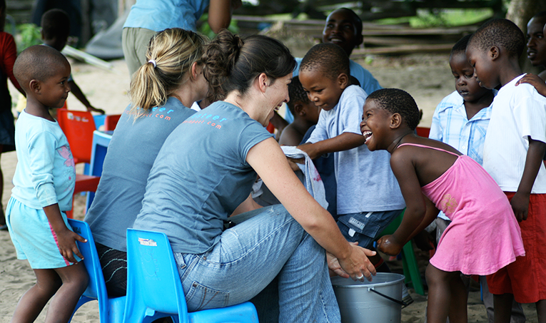 Volunteers practicing handwashing with children in South Africa