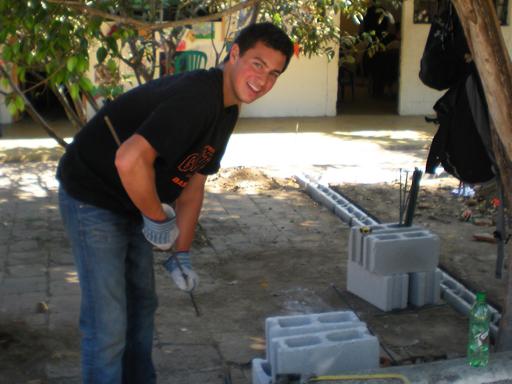 Construction volunteer preparing rebar